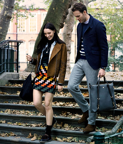 Fashion lifestyle film of a couple walking through Autumn leaves