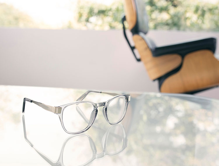 Fashion lifestyle photography of Oliver Peoples clear frame glasses