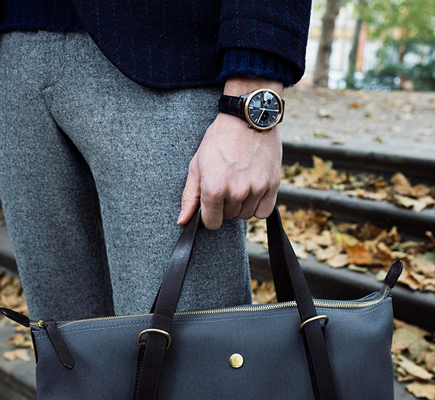 Fashion lifestyle photography of Uniform Wears men's chronograph watch and Mismo bag